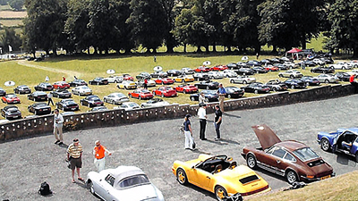 Concours cars in the foreground and photo trail cars on the grass beyond at the Celtic Manor Hotel, the lunchtime stop-over for the Photo Rally